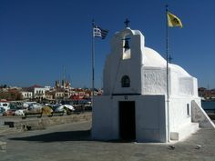 The picturesque chapel of Agios Nikolaos, guardian Saint of sailors, at the port of Aegina, Greece