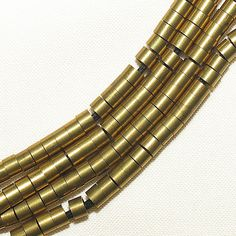 70 vintage brass  rollers  uncirculated tubular beads african trade #134a