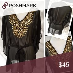👁🗨Gorgeous Michael Kors Sheer Top👁🗨 This gorgeous top is adorned with beautiful gold embellishments. It is very comfy and has a tie at the waist to give it a touch of being fitted. Very classy and can be worn with leggings or jeans. You can dress it up or dress it down. Very versatile top! MICHAEL Michael Kors Tops Blouses
