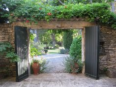 love gardens that take your eye through a beautiful doorway