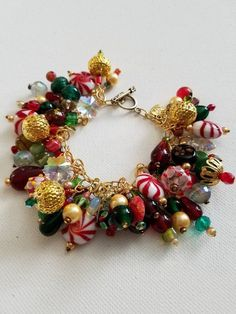 Peppermint Christmas beaded charm bracelet with wire wrapped glass beads, Christmas jewelry, holiday jewelry, candy cane charm bracelet - JewelryCreationsbyLV - Bracelets I Love Jewelry, Charm Jewelry, Jewelry Crafts, Beaded Jewelry, Jewelry Bracelets, Handmade Jewelry, Jewelry Making, Silver Jewelry, Making Bracelets
