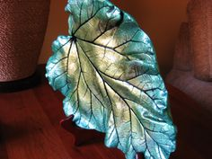 Material - High quality cement. Size - 9 x 11 inches. Colors - Metallic emerald green, metallic light festive green, metallic green peridot and black veins. Indoor / Outdoor - Indoor. Wooden display stand - Included. Shipping - USPS parcel post 7-10 days Please contact me for international shipping rates. Express and priority mail also available upon request. Extra postage will be added to your purchase. Local pick up available to save on shipping cost.