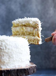 The Very Best Coconut Cake Recipe EVER! Fluffy, soft, with the perfect amount of coconut flavor, topped with creamy coconut buttercream frosting! #cookiesandcups #coconutcake #cakerecipe #cake #buttercream #coconutfrosting Best Coconut Cake Recipe Ever, Best Cake Recipes, Coconut Recipes, Baking Recipes, Dessert Recipes, Southern Coconut Cake Recipe, Ark Recipes, Delicious Desserts, Dessert Tray
