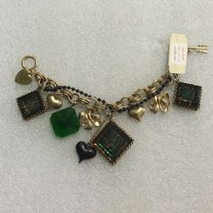 Betsey Johnson  bracelet Selling to buy Betsey pieces I need. This is from the plaid collection. Gold tone bracelet. The charms include 3 lucite plaid squares, bows and puffy hearts. Missing but blue square and not that noticeable. New Betsey Johnson Jewelry Bracelets