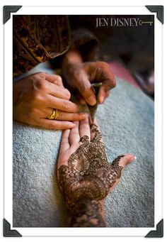 Applying mehendi