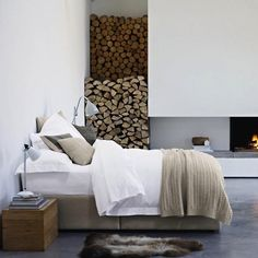 the bed is beautiful and the fireplace is great, but there would be thousands of bugs in your bedroom (not to mention dirt) if you stored wood there.
