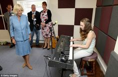 Camilla watches a performance during a visit to the Llandovery YMCA, which was founded in 1990 to provide a safe meeting place for the young people of the town and surrounding villages