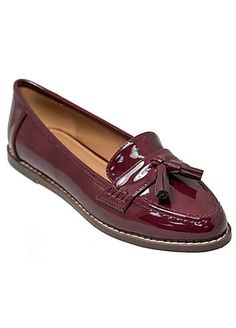 Classic style patent loafers with tassel detail and small heel. Loafers Features: All: Synthetic