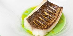 This sea bass recipe results in a simple yet elegant meal by Galton Blackiston. Pea and mint soup provides a tasty and cosy side to the wild sea bass.