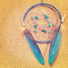 The Real Macaw made by me this dream catcher is a nice blue complimented by pony beads in different shades and two prominent Blue Macaw feathers. Blue Macaw, Pony Beads, Dreamcatchers, Feathers, Compliments, Shades, Yellow, Nice, Artwork