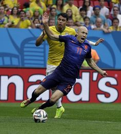 Netherlands' Arjen Robben, front, is tripped by Brazil's Thiago Silva during the World Cup third-place soccer match between Brazil and the Netherlands at the Estadio Nacional in Brasilia, Brazil, Saturday, July 12, 2014. The Netherlands scored on a penalty shot awarded for the incident. (AP Photo/Natacha Pisarenko)