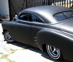 Highly customized flat-black chopped and channeled '51 Mercury parked at a body shop next to a tattoo parlor on Melrose Avenue a few feet east of Cahuenga Boulevard, just south of Hollywood