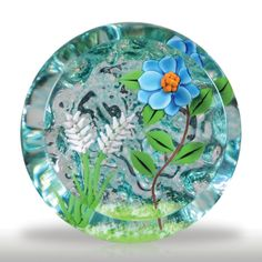 William Manson 1997 blue flower and white spears textured paperweight.(157) images