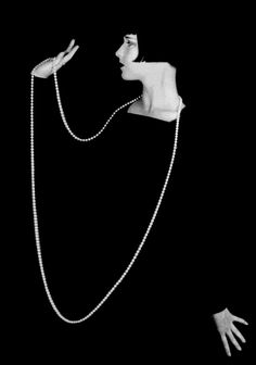 Louise Brooks with pearls (1920s) ~photographer: Eugene Robert Richee