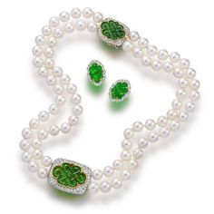 A cultured pearl, jadeite and diamond necklace and earclips.