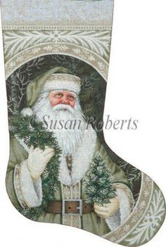 """Evergreen Santa stocking painted canvas by Susan Roberts, Artwork by Liz Goodrick Dillon Size: 13.25"""" x 20.75"""" Mesh Count: 13"""