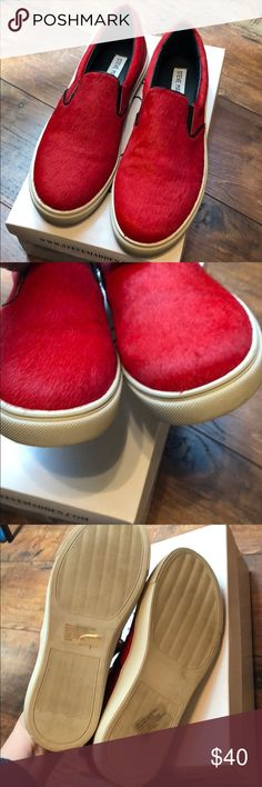 Steve Madden bright red slip on sneakers size 8 Steve Madden bright red slip on sneakers size 8. EUC. Maybe worn twice. Comes with Box. Dyed horse hair. No holds or trades  Perfect for Razorbacks, STL Cardinals, Arizona cardinals, Georgia, NC State, or Louisville fans Steve Madden Shoes Sneakers