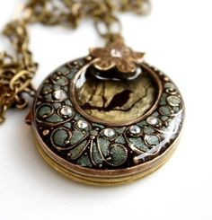 MStevensonDesigns  http://www.etsy.com/listing/93628551/locket-green-locket-bird-locket-vintage?ref=tre-2722746042-4