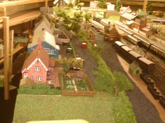 Gardeners cottage,village hall and country station siding, aspire gifts and models shop model railway layout, model trains, model railways