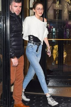 Gigi Hadid wearing Gucci Blooms Iphone Case, Sandro Paris Miren Straight Cut Jeans, Dr. Martens 939 Boots and Unravel Distressed Cotton-Cashmere Sweater