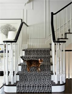 black + white staircase with greek key runner