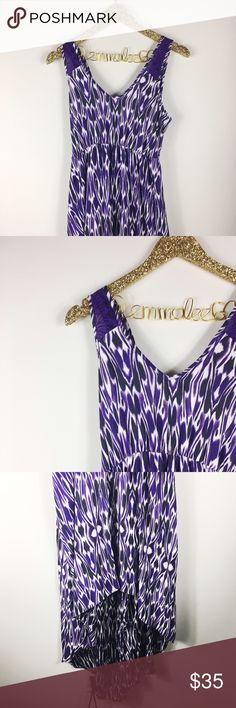 """Express Purple Printed High-low Maxi Dress Express purple printed high-low Maxi dress. Lace strap details with a cut out in the back. Adorable and in great condition. Size M. Front length measures 36"""", back length measures 52"""", arm to arm across chest 16"""". 100% polyester. No modeling/trades. Express Dresses High Low"""