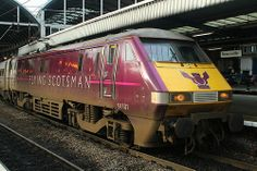 East Coast's 'Flying Scotsman' vinyled Class 91 91101 is pictured on Platform 2 at Newcastle Central, at the head of the to Edinburgh Waverley, on November Electric Locomotive, Diesel Locomotive, Flying Scotsman, British Rail, Train Engines, Newcastle, East Coast, Edinburgh, Trains