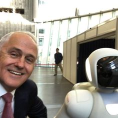 Prime Minister Malcolm Turnbull snaps a robot selfie before talks with Japanese counterpart Shinzo Abe.