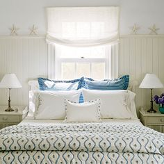 I don't like beds under windows if there'a any alternative, but I love the cool color scheme & the starfish along the high wainscoating. | Coastal Living