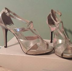 Silver strapy heels Silver strapy heels. Worn twice. Fioni Night from Payless. Size 10. Got these for my senior year homecoming! Go ahead and make an offer! Shoes Heels