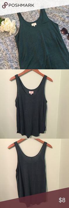 🌸NEW ARRIVAL🌸 LOFT Casual Tank Super comfy dark teal tank from LOFT's Lou & Grey collection. Has one tiny tiny hole on the front of the shirt but it is barely noticeable when worn and could be easily sewn - price reflective of this. Otherwise in great condition. Comment any questions! Open to offers!!🙊 LOFT Tops Tank Tops