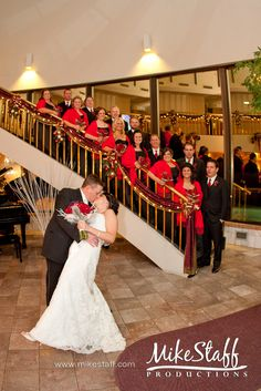 bridal party on stairs with bride and groom in front :)