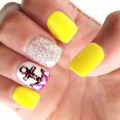 White and yellow glitter nail art design with an anchor detail in white, black and magenta polish.