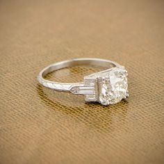 A classic and beautiful Antique Style Art Deco Engagement Ring. This stunning Ring is set in a handmade platinum mounting.