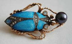 "Gold scarab brooch. Russia. Circa 1910's - guilloche enamel, diamonds in silver sets, topazes, mikomoto pearl. Marked ""ГАСЛ""."