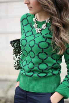 Preppy green sweater with a flowered jewel necklace.