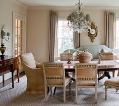 Cindy Smith - Circa Interiors & Antiques. Elegant and refined yet inviting and relaxed. I particularly like the setee half covering the windows behind the dining set as well as the shape of it