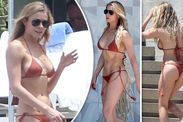Bikini clad girl braves tropical water to feed WILD animal - http://travelr.co/uncategorized/bikini-clad-girl-braves-tropical-water-to-feed-wild-animal/
