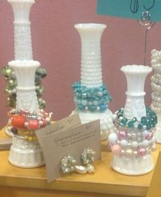 Cool bracelet holder idea!  Can make with any glass vase or container - pour white paint insides, empty and let dry.