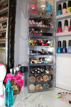 Desktop makeup storage, fingernail polish in a built-in wall rack.