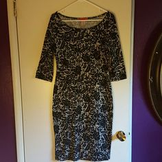 Floral patterened, black/white mini dress This mini dress is made of polyester and spandex, to show all those curves.  Great length right above knees.  With beautiful floral pattern Analogy  Dresses