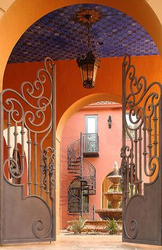 Custom spiral stairs & driveway entry gates by DecoDesignCenter.com, via Flickr ~ Pinecrest, Florida