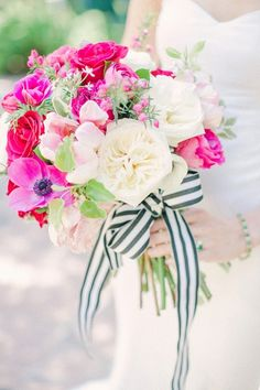 Kate Spade Inspired Pink Bouquet Tied with a Black and White Striped Ribbon | Sharon Nicole Photography | See More! http://heyweddinglady.com/chic-modern-black-and-white-wedding-inspiration-with-brilliant-fuchsia/