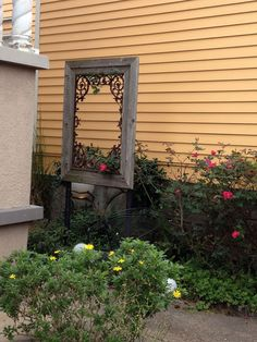 This is such a neat idea, framing iron work could work inside or outside. Very nice.