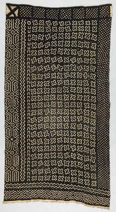 Africa | Wrapper ~ bokolanfini ~ from the Bamana people of Mali | 20th century | Mud cloths (bogolanfini) are traditionally worn as wrappers by young women undergoing initiation rites, and by hunters to provide protection in the dangerous bush environment.