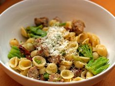 Dinner Tonight: Orecchiette with Sausage, Broccoli, and Caramelized Garlic- Ingredients      8 oz. Pasta Lensi Farfalle     2 Tbsp. extra virgin olive oil     1 lb. Italian Sausage, casing removed, thinly sliced     4 cloves garlic, sliced     1/4 tsp. crushed red pepper     1 1/2 lbs. broccoli rabe, washed & sliced into 2-inch pieces     1 cup chicken broth     2 Tbsp. butter     1/3 cup grated Parmesan cheese