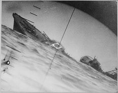 Sources indicate this was likely taken through the periscope of the Narwhal-class submarine USS Nautilus after it torpedoed and sank the Japanese Destroyer Yamakaze on June 25, 1942.