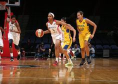 Tayler Hill brings the ball up against the Brazilian National Team
