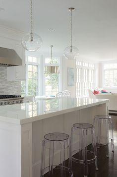 white cabinets + white/gray glass backsplash + white quartz counters