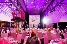Austin Texas Event, Uplighting, Room Wash, Chandeliers, Floral Pinspotting, Pink, Purple, Interactive Lighting, Pinspotting, ILD Lighting,